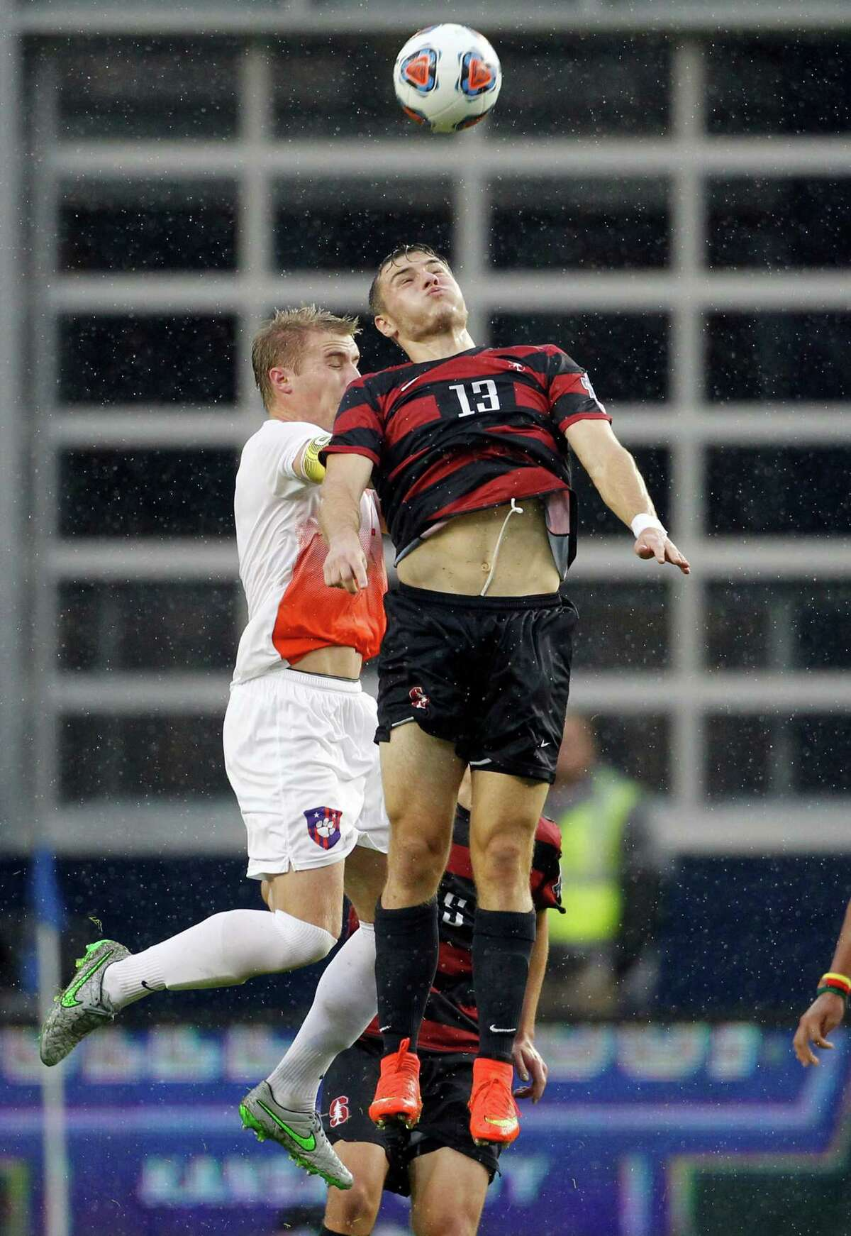 Clemson defender Patrick Bunk-Andersen, left, and Stanford forward Jordan Morris (13) go up for the ball in the first half of an NCAA College Cup championship soccer match, Sunday, Dec. 13, 2015, in Kansas City, Kan. Stanford defeated Clemson 4-0. (AP Photo/Colin E. Braley)