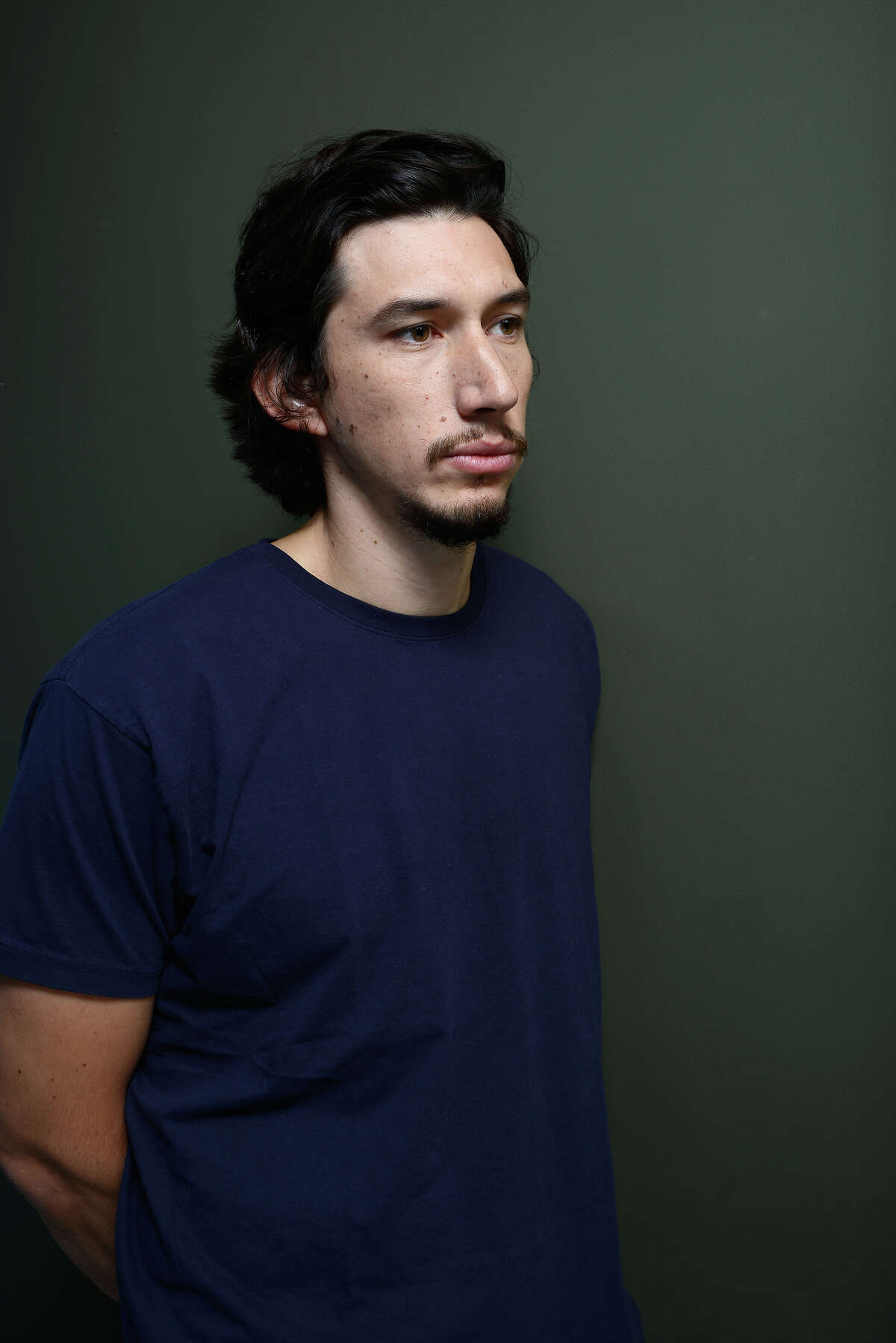 Actor Adam Driver of 'Tracks' poses at the Guess Portrait Studio during 2013 Toronto International Film Festival on September 10, 2013 in Toronto, Canada.