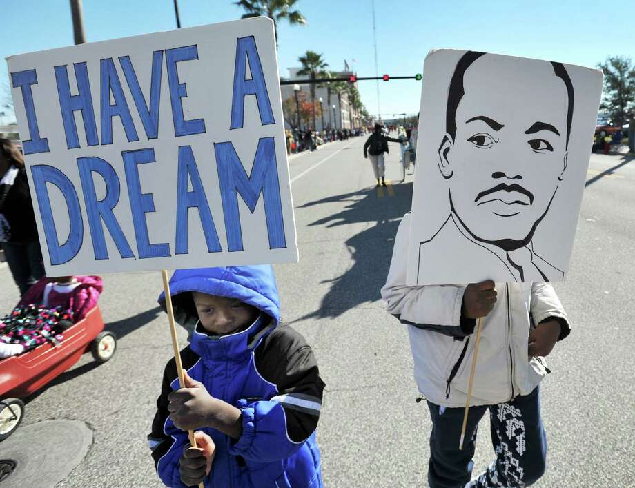 Americans just spent several days reflecting on Martin Luther King Jr. and honoring his importance to the nation's social progress. If King were here today to moderate a bipartisan debate on guns, the discussion would be different. The pithy one-liners wouldn't fly if he were here. Photo: Bob Self /Associated Press / The Florida Times-Union