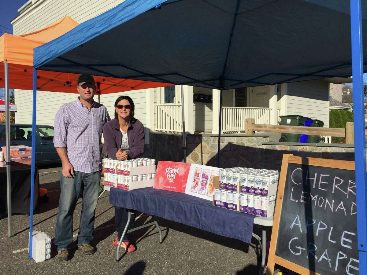 Amy and Tom Barnouw, of Fairfield, with Planet Fuel Beverage Co. juice at the Colony Grill Hot Oil Race.