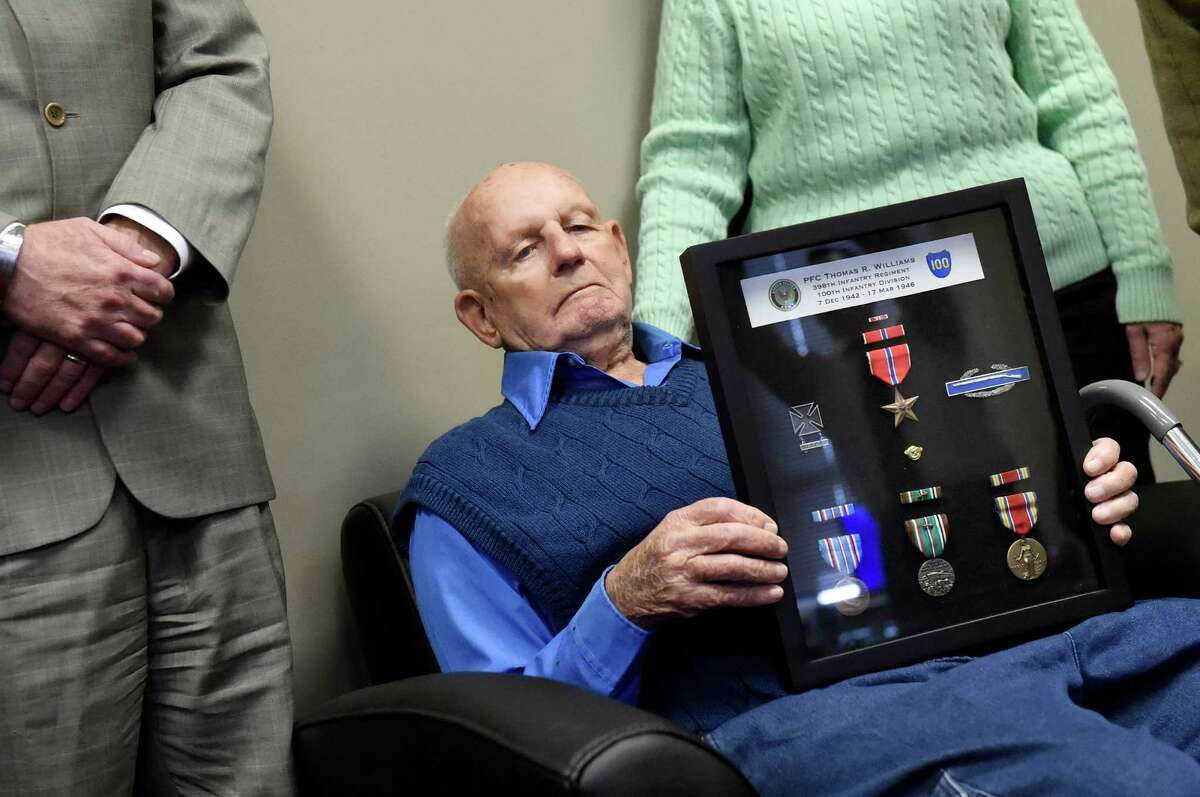 Thomas Williams, 92, of Central Bridge holds World War II medals he received from Rep. Chris Gibson during a ceremony on Tuesday, Jan. 19, 2016, at the Montgomery County Annex in Fonda, N.Y. (Cindy Schultz / Times Union)
