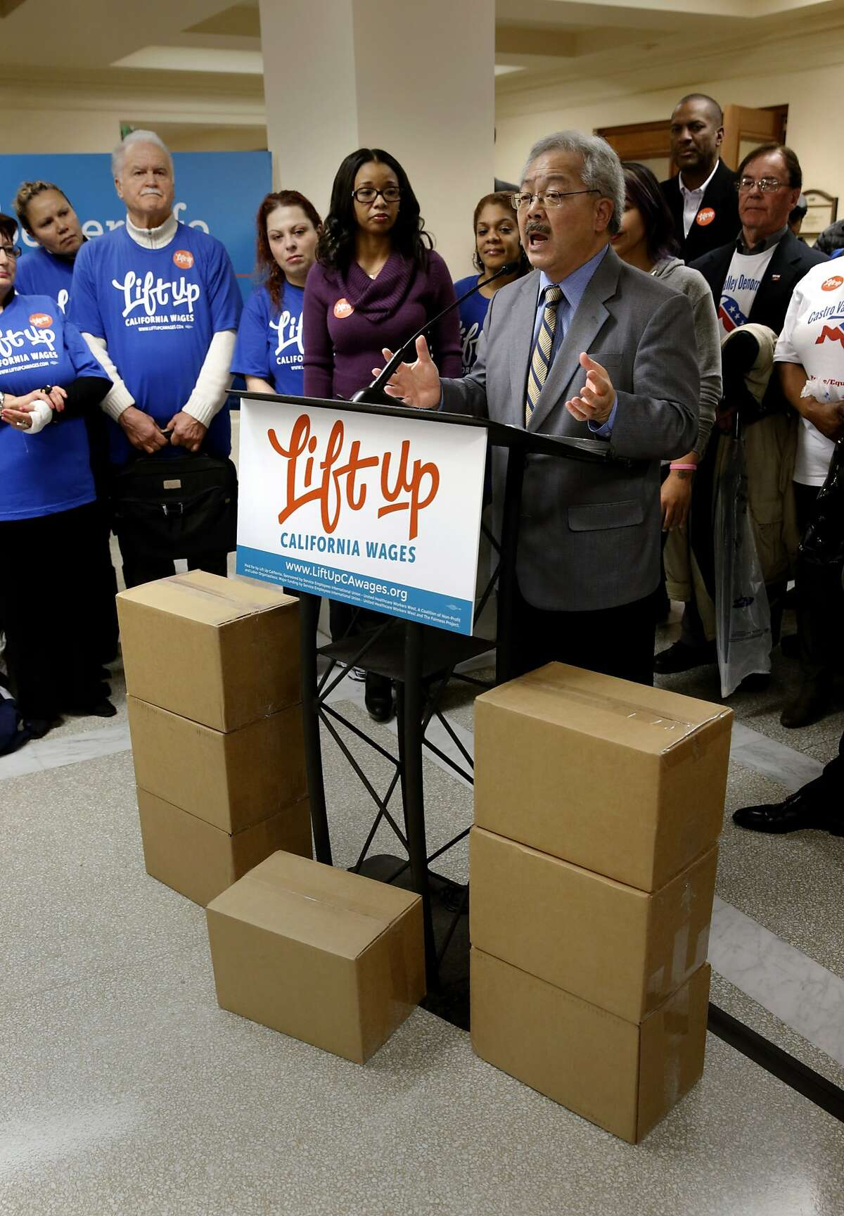 Mayor Ed Lee addresses supporters in front of boxes filled with more than 600,000 voter signatures set for delivery to the San Francisco Department of Elections to qualify the Fair Wage Act of 2016 on the ballot, at City Hall in San Francisco , Calif., on Tues. January 19, 2016,