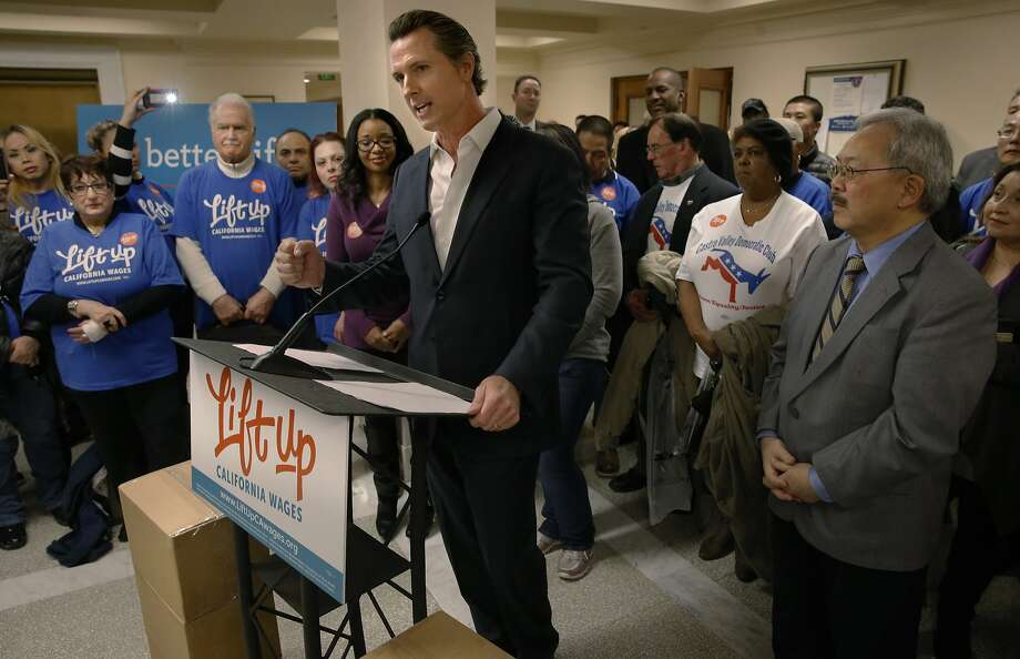 California Lt. Governor Gavin Newsom addresses supporters with Mayor Ed Lee close by, in front of boxes filled with more than 600,000 voter signatures set for delivery to the San Francisco Department of Elections to qualify the Fair Wage Act of 2016 on the ballot, at City Hall in San Francisco , Calif., on Tues. January 19, 2016, Photo: Michael Macor, The Chronicle