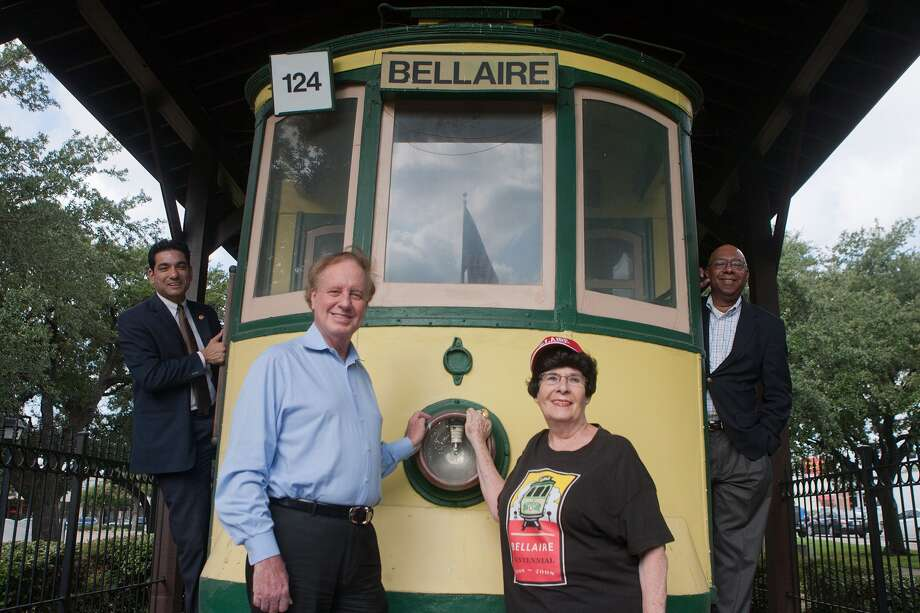 Bellaire Historical Society board members Randy McKinney, left, Patrick Durio, secretary Lynn McBee and Winfred Frazier are shown with the trolley in the Bellaire esplanade on South Rice in a shot taken several years ago. The society's goal is to preserve and promote the city and its history. Photo: R. Clayton McKee, Freelance / © R. Clayton McKee