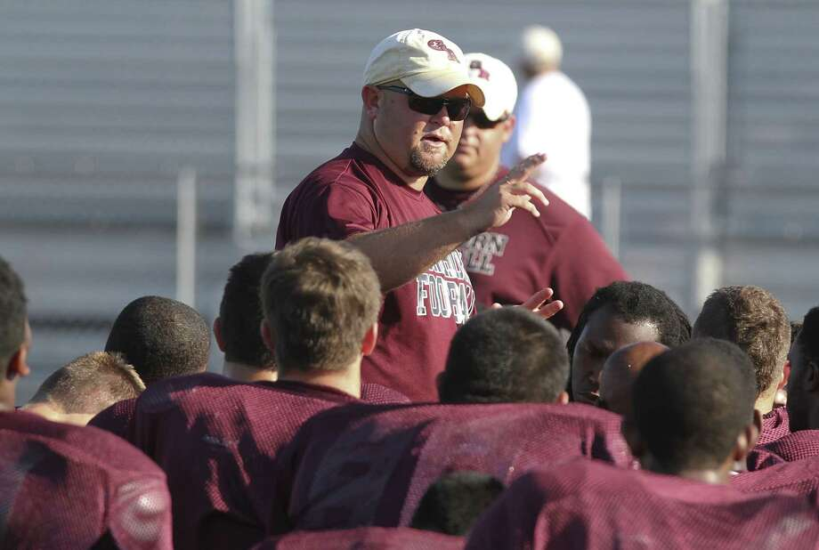 George Ranch head coach Ricky Tullos and the Class 5A state champion Longhorns are expected to move up to Class 6A when the UIL realigns districts next month. Photo: Diana L. Porter, Freelance / © Diana L. Porter