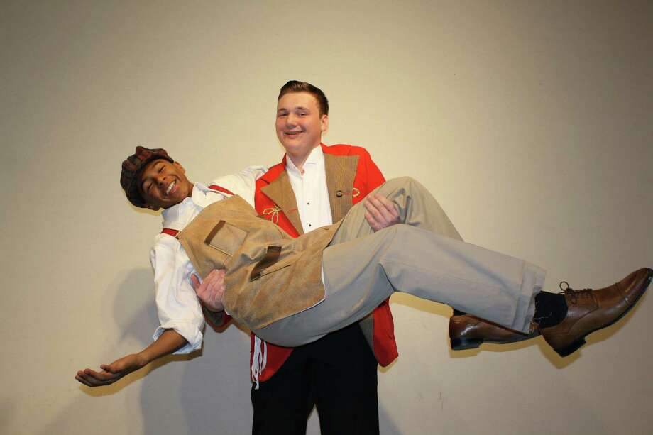 "Noah Klitus as Harold Hill holds Deandre Fontenot as Marcellus Washburn during a rehearsal for ""The Music Man"" set at Porter High School Jan. 21-23. Photo: Courtesy"