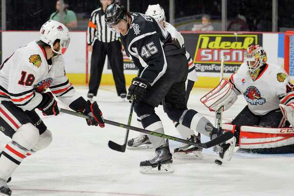 Rampage right wing Dennis Everberg (45) deflects the puck toward Rockford IceHogs goaltender Michael Leighton (right) during the second period of an AHL hockey game on Dec. 6, 2015, in San Antonio.