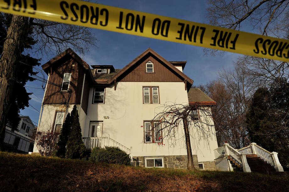 The multi-family house at 52 Highland Road in Stamford, Conn., is pictured on Thursday, Dec. 4, 2014. On Dec. 3, police say the owner, Anthony Manousos, allegedly set fire to the building with a tenant still inside. Photo: Jason Rearick / Jason Rearick / Stamford Advocate