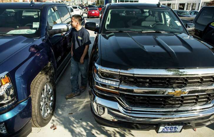 New trucks at Knapp Chevrolet in Houston earlier this year. Across the region, sales are down 22 percent from last year. ( Brett Coomer / Houston Chronicle )