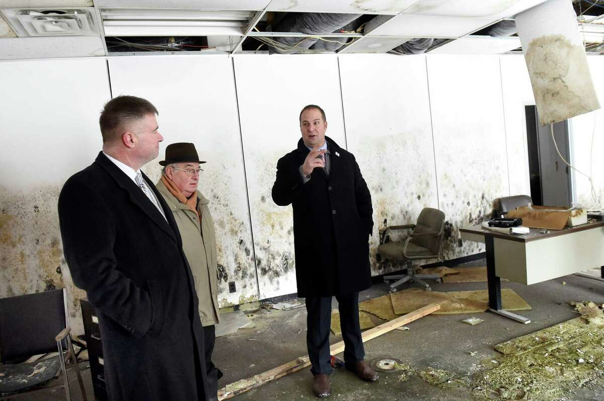 Montgomery County Executive Matt Ossenfort, right, speaks during a tour of the former Beech-Nut plant with Rep. Chris Gibson, left, and Mayor Francis Avery on Tuesday, Jan. 19, 2016, in Canajoharie, N.Y. (Cindy Schultz / Times Union)