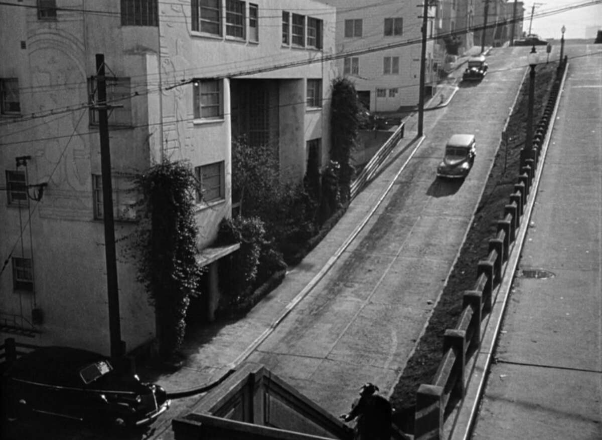 One of the great film noirs set in San Francisco is the 1947 Bogart and Bacall thriller 'Dark Passage.' In it, Humphrey Bogart's character, who was convicted of killing his wife, escapes from San Quentin hell-bent on proving his innocence. He's picked up by Lauren Bacall, who helps hide him at her apartment, seen here on 1360 Montgomery St.