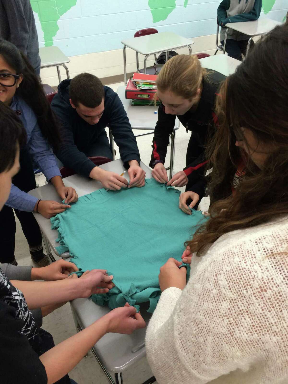 Niskayuna High School students make a blanket for Project Linus at last year's Charity Week