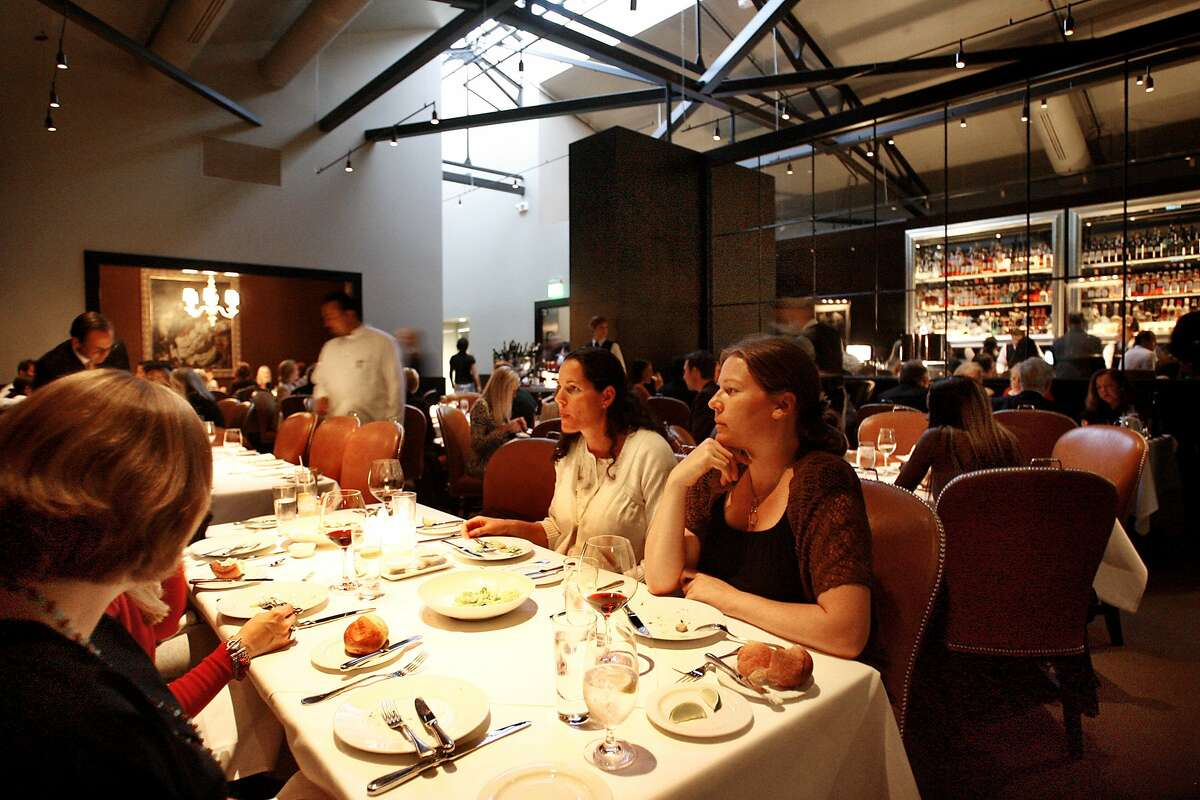 d.14SPRUCE_082_RAD.jpg SHOWN: One of the dining rooms at Spruce, an important restaurant that has just opened in San Francisco at 3640 Sacramento St. (Katy Raddatz/The Chronicle) ** Ran on: 10-14-2007 The barnlike but warm dining room at Spruce, in a former auto barn on Sacramento Street.