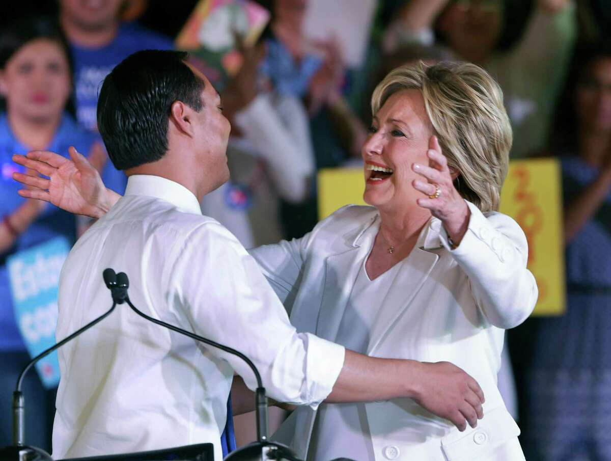Presidential candidate Hillary Clinton, right, embraces former San Antonio mayor, U.S. Secretary of HUD Julian Castro before she spoke to supporters at a rally on Thursday, Oct. 15, 2015 at Sunset Station in San Antonio.