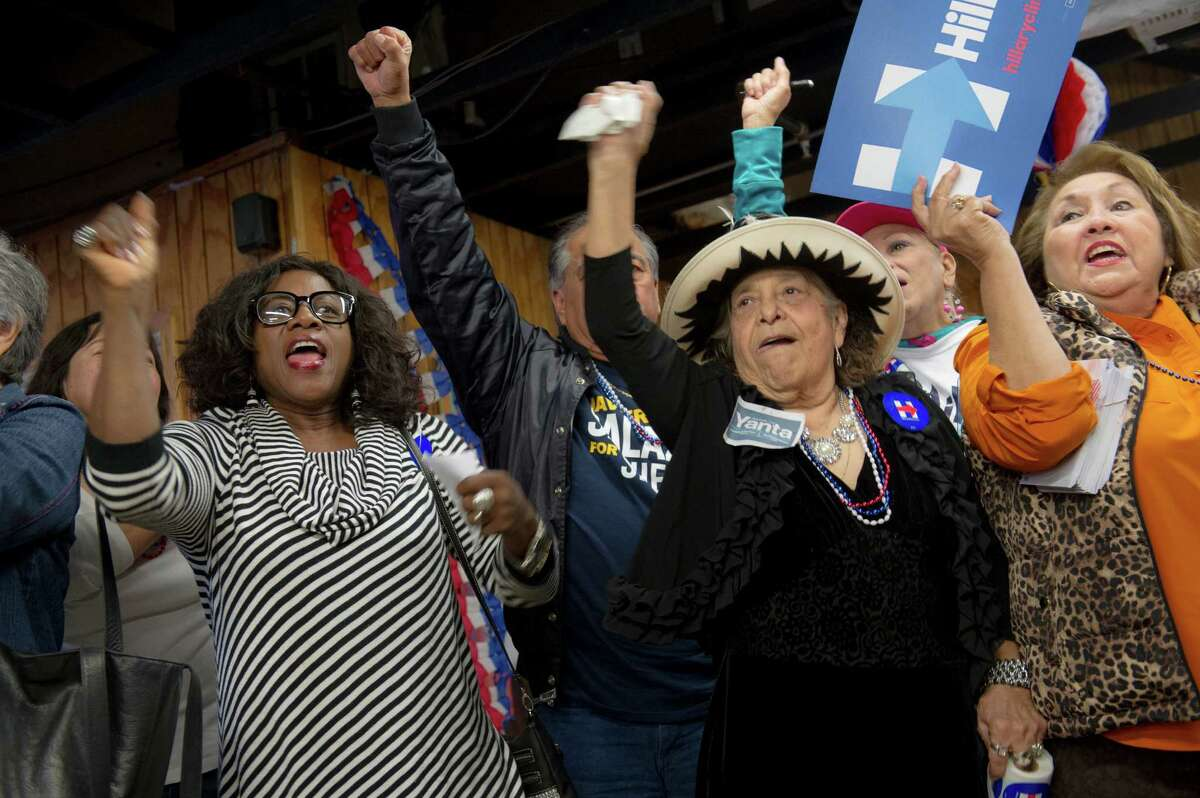 Supporters of Hillary Clinton's campaign cheer as candidates began filing for Bexar county positions on Saturday, November 14, 2015.