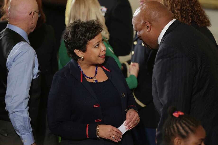 U.S. Attorney General Loretta Lynch (center) talks with victims of gun violence, their families and supporters afterPresident Obama delivers remarks about his efforts to increase federal gun control in early January. Readers criticize the efforts to curb gun violence. Photo: Chip Somodevilla /Getty Images / 2016 Getty Images
