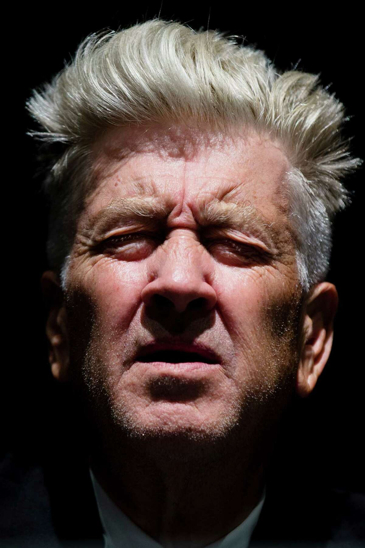 David Lynch closes his eyes as he speaks during a press preview of David Lynch: The Unified Field, Wednesday, Sept. 10, 2014, at his former school The Pennsylvania Academy of the Fine Arts (PAFA) in Philadelphia. The show is schedule to be on view from Sept. 13, 2014 to Jan. 11, 2015, and is the first major U.S. museum exhibition of the filmmaker and PAFA alumnus' work. (AP Photo/Matt Rourke) ORG XMIT: PAMR108