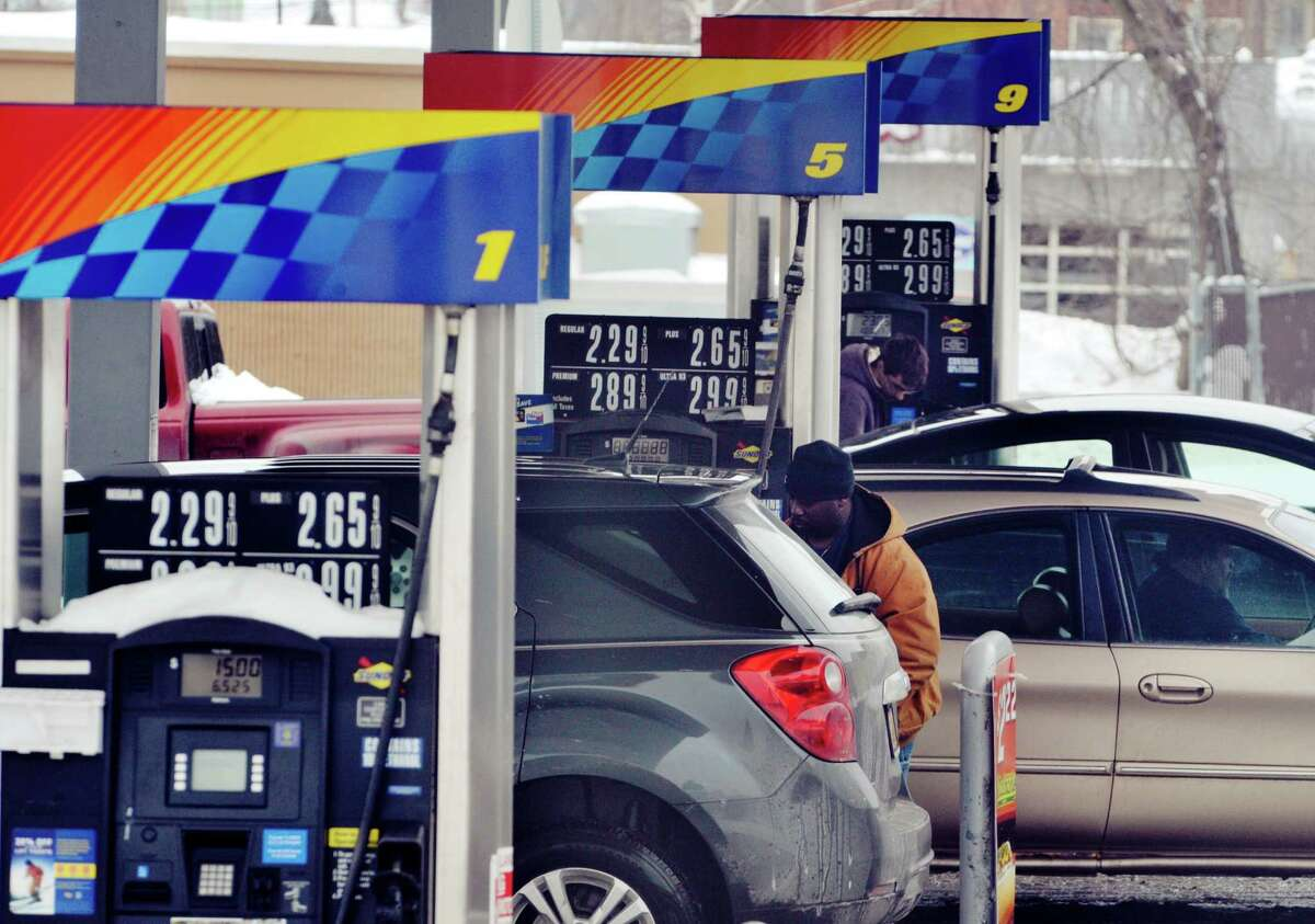 Drivers fill up their vehicles at a Sunoco station on Wednesday, Feb. 4, 2015, in Cohoes, N.Y. (Paul Buckowski / Times Union archive)