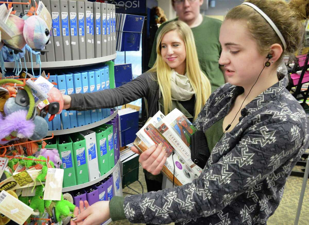 Students Kate Gagnon, left, of Averill Park and Ashley Berry of Clifton Park look over as they wait in a long line at the campus bookstore as the Spring 2016 semester begins at Hudson Valley Community College Tuesday Jan. 19, 2016 in Troy, NY. (John Carl D'Annibale / Times Union)