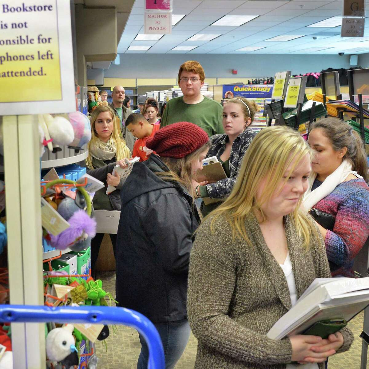 Students wait in a long line at the campus bookstore as the Spring 2016 semester begins at Hudson Valley Community College Tuesday Jan. 19, 2016 in Troy, NY. (John Carl D'Annibale / Times Union)