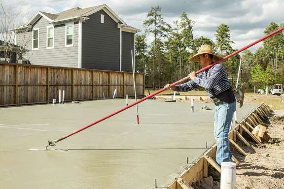 New homes are under construction in the Springwoods Village subdivision, a new master-planned community near the Exxon Mobil campus, on Tuesday, Jan. 19, 2016, in Spring. ( Brett Coomer / Houston Chronicle )
