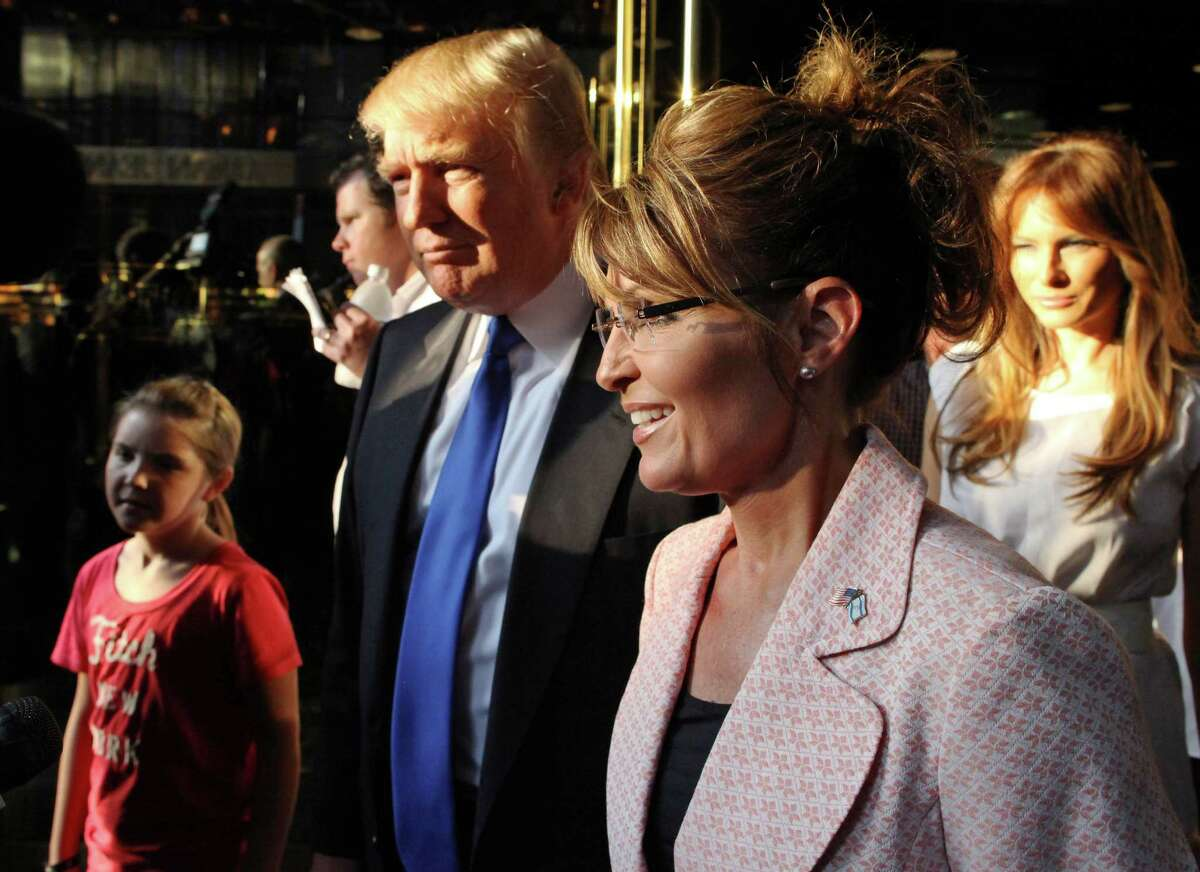 Donald Trump is shown with Sarah Palin in New York City in 2011.