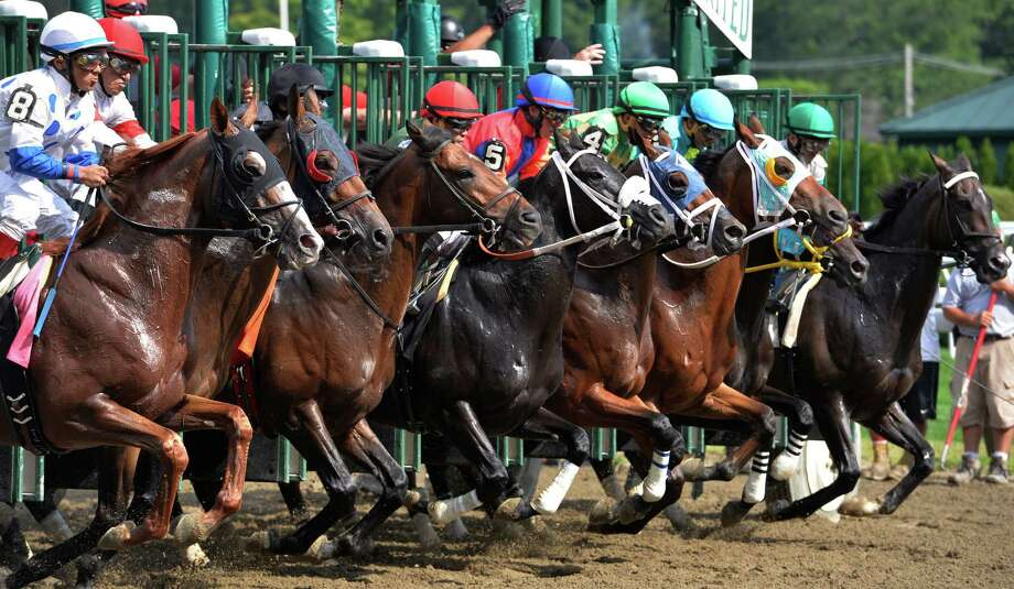 The sixth race field charges out of the gate Friday afternoon, Aug. 14, 2015, at Saratoga Race Course in Saratoga Springs, N.Y. (Skip Dickstein/Times Union archive) Photo: SKIP DICKSTEIN