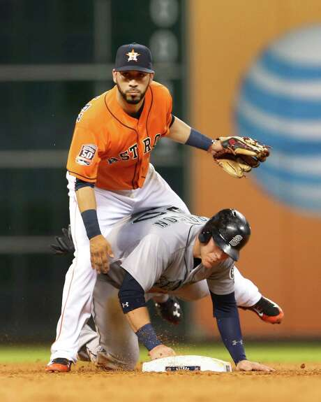 Marwin Gonzalez, top, saw action at all four infield positions in 2015, with 43 games at first base the heaviest load. He also logged 15 games in left field. Photo: Karen Warren, Staff / © 2015 Houston Chronicle