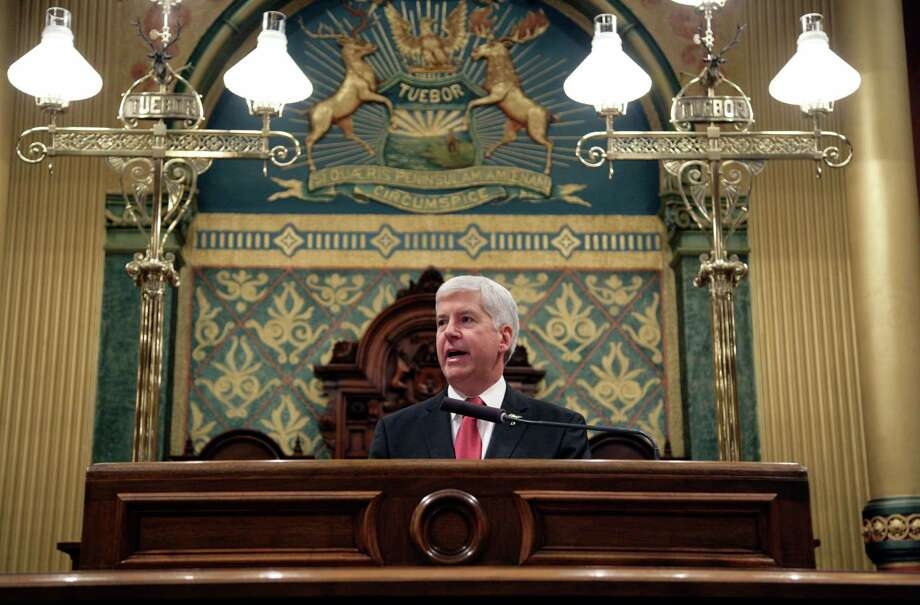 Michigan Gov. Rick Snyder apologizes but rejects calls for his resignation in his State of the State address Tuesday at the state Capitol in Lansing. Photo: Al Goldis, FRE / FR11125 AP