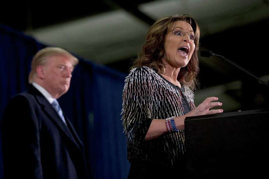 Former Alaska Gov. Sarah Palin, right, endorses  Republican presidential candidate Donald Trump during a rally at the Iowa State University, Tuesday, Jan. 19, 2016, in Ames, Iowa. Photo: Mary Altaffer, AP / AP