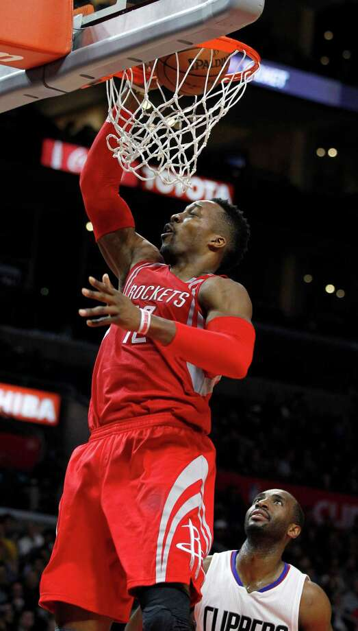 Dwight Howard scores two of his 36 points Monday, the highest total in his three seasons as a Rocket. Photo: Alex Gallardo, FRE / FR170211 AP