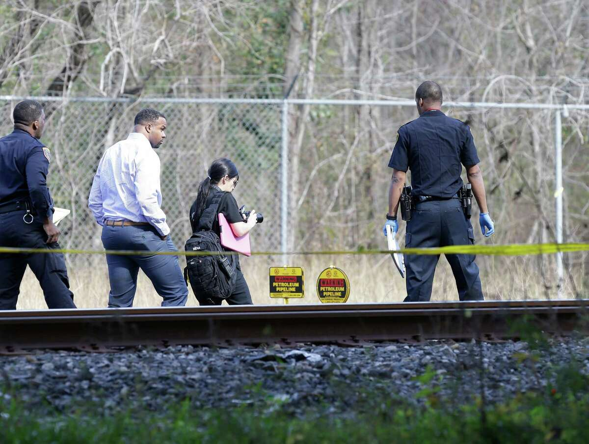 Houston police investigate the scene where the body of Ryan Robert, 16, was found dead Tuesday, Jan. 19, 2016in a wooded area along the 4600 block of Holmes Road near 610. Police suspect foul play in the death of the Davis High student, who had been missing since the prior Friday.