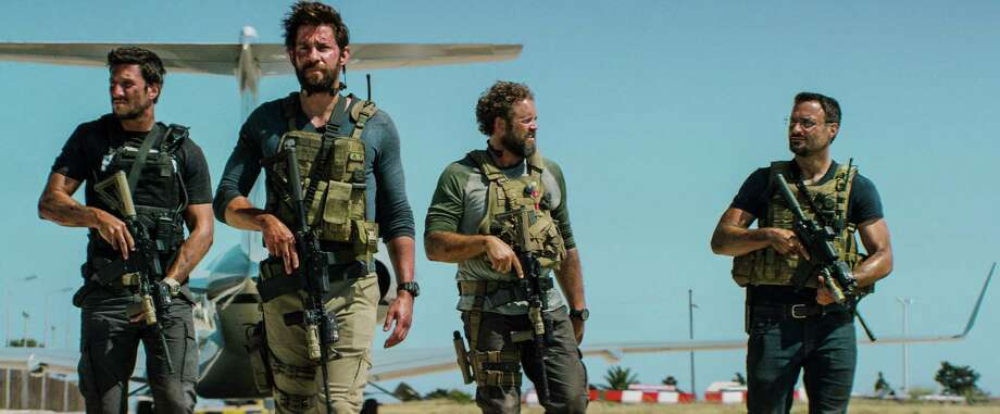 """The recently released film """"13 Hours: The Secret Soldiers of Benghazi"""" stars, from left, Pablo Schreiber, John Krasinski, David Denman and Dominic Fumusa portraying American military contractors in Benghazi, Libya, at the time of the 2012 embassy attack. The former real-life CIA station chief in Benghazi is disputing several of scenes and protrayals in the film.  Photo: HONS / Paramount Pictures"""
