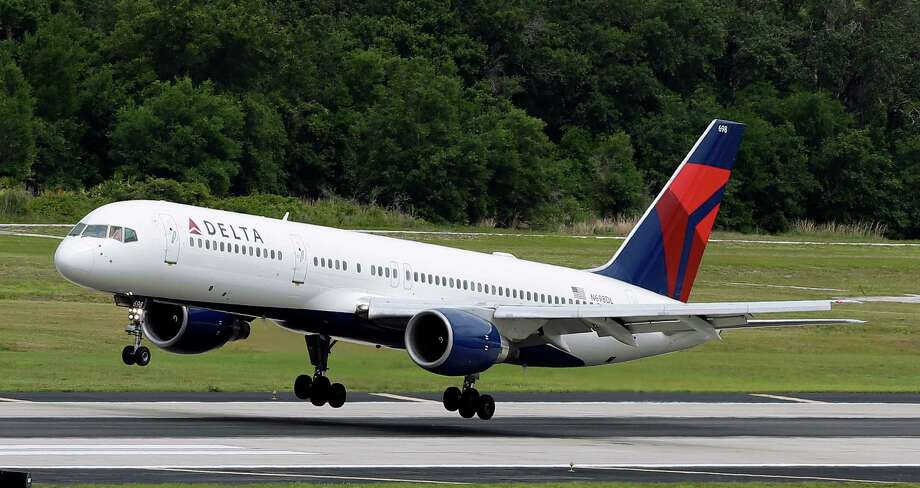 FILE - In this May 15, 2014, file photo, a Delta Air Lines Boeing 757-232 lands at Tampa International Airport in Tampa, Fla. Delta reports quarterly financial results on Tuesday, Jan. 19, 2016. (AP Photo/Chris O'Meara, File) Photo: Chris O'Meara, STF / AP