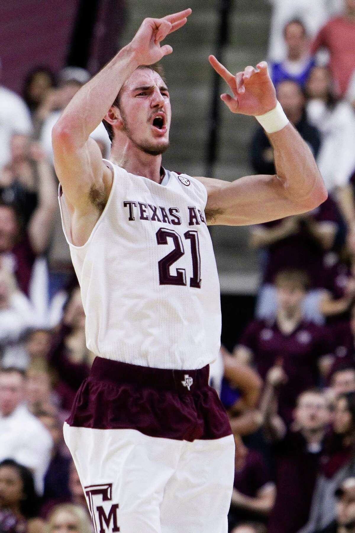 Texas A&M Aggies guard Alex Caruso (21) pumps up the crowd as LSU takes a timeout as Texas A&M takes on LSU Tuesday, Jan. 19, 2016, in College Station.