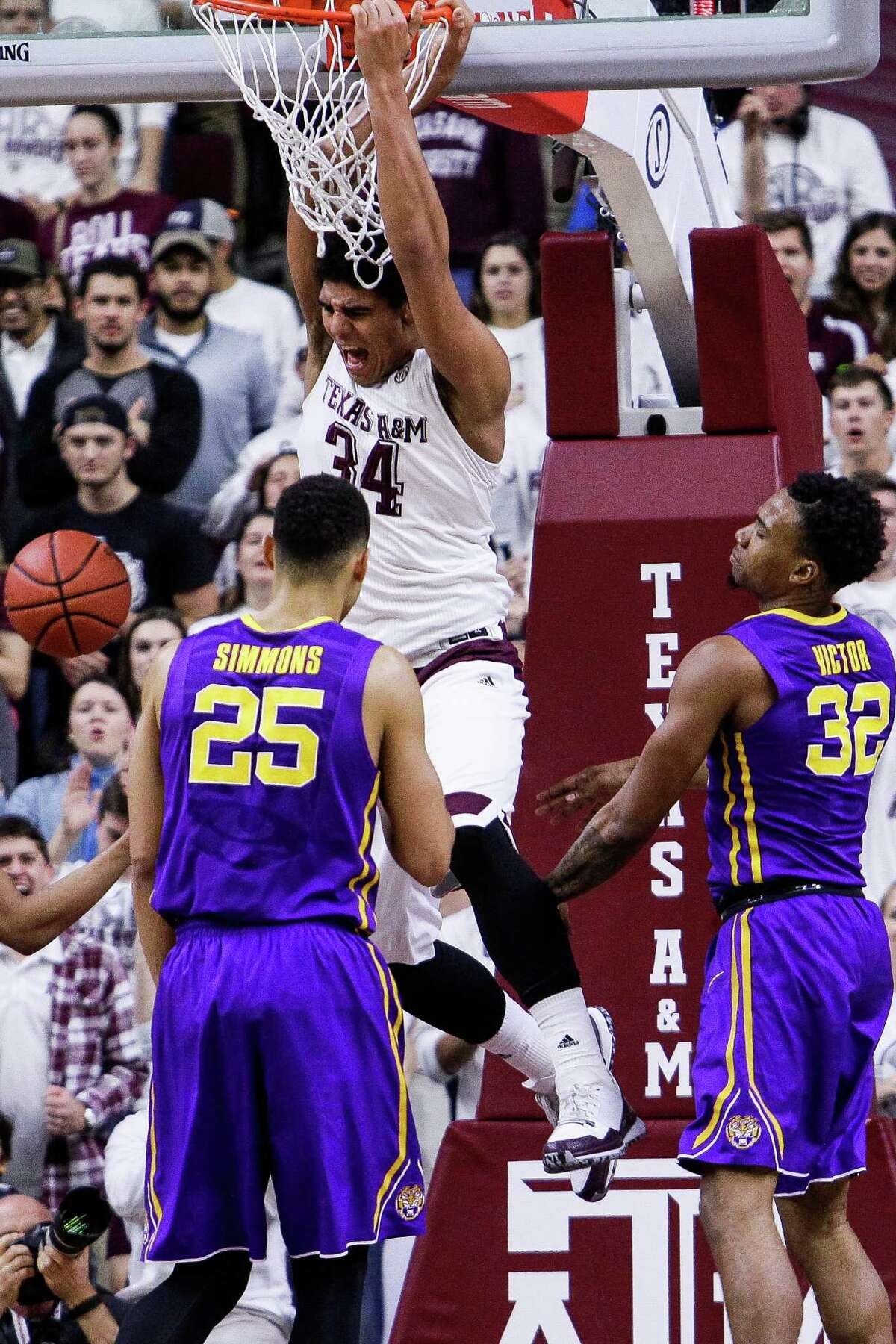 Texas A&M Aggies center Tyler Davis (34) dunks the ball as Texas A&M takes on LSU at Reed Arena Tuesday, Jan. 19, 2016, in College Station.