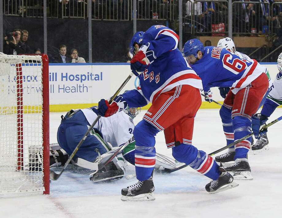 Rangers top Canucks on Miller s goal in OT - Times Union 764ec43a3