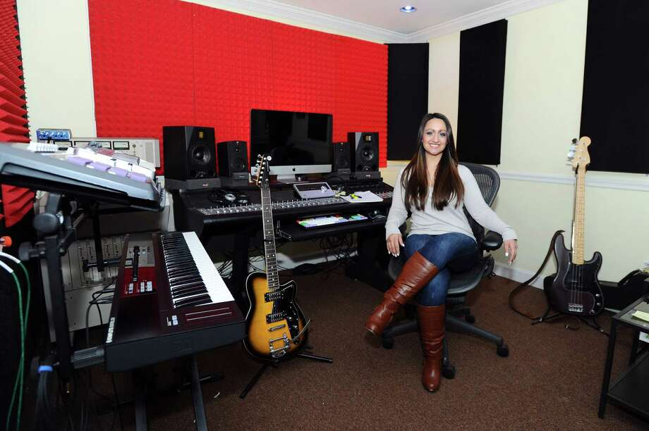 Christine Occhino, owner of The Pop Music Academy, poses for a photo in her studio. Occhino is raising funds for her new non-profit called Hope in Harmony, which brings music and music therapy to patients in area heathcare facilities. Photo: Michael Cummo / Hearst Connecticut Media / Stamford Advocate