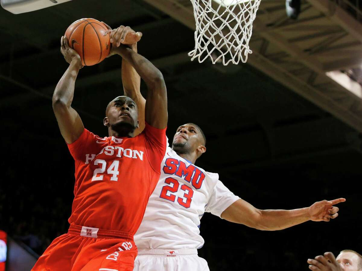 Houston's Devonta Pollard (24) goes up for a shot as SMU's Jordan Tolbert defends in the first half of an NCAA college basketball game, Tuesday, Jan. 19, 2016, in Dallas. (AP Photo/Tony Gutierrez)