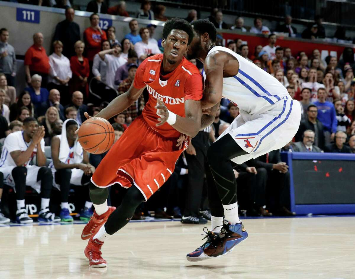 Houston forward Danrad Knowles (0) drives to the basket past SMU forward Markus Kennedy, right, in the first half of an NCAA college basketball game, Tuesday, Jan. 19, 2016, in Dallas. (AP Photo/Tony Gutierrez)
