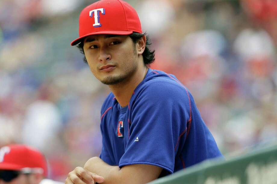FILE - In this Sunday, Aug. 30, 2015 file photo,Texas Rangers pitcher Yu Darvish of Japan watches from the dugout during a baseball game against the Baltimore Orioles in Arlington, Texas. Yu Darvish says he has never been involved in gambling activities, but otherwise isn't commenting on a Major League Baseball investigation after the arrest of his younger brother in Japan. Darvish issued a statement Tuesday, Jan. 19, 2016 through his agent that says he understands MLB must conduct an investigation. But the Texas Rangers pitcher says he's certain they will find he had no involvement whatsoever. (AP Photo/LM Otero, File) Photo: LM Otero, STF / AP