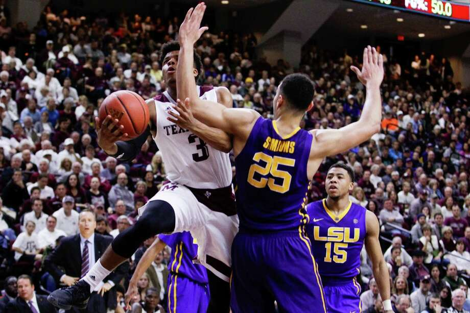 Texas A&M's Admon Gilder, left, doesn't back down from the challenge of driving on ballyhooed LSU freshman Ben Simmons, who had a relatively quiet Tuesday night with 10 points and 11 rebounds in front of a full house at Reed Arena. Photo: Michael Ciaglo, Staff / © 2016  Houston Chronicle