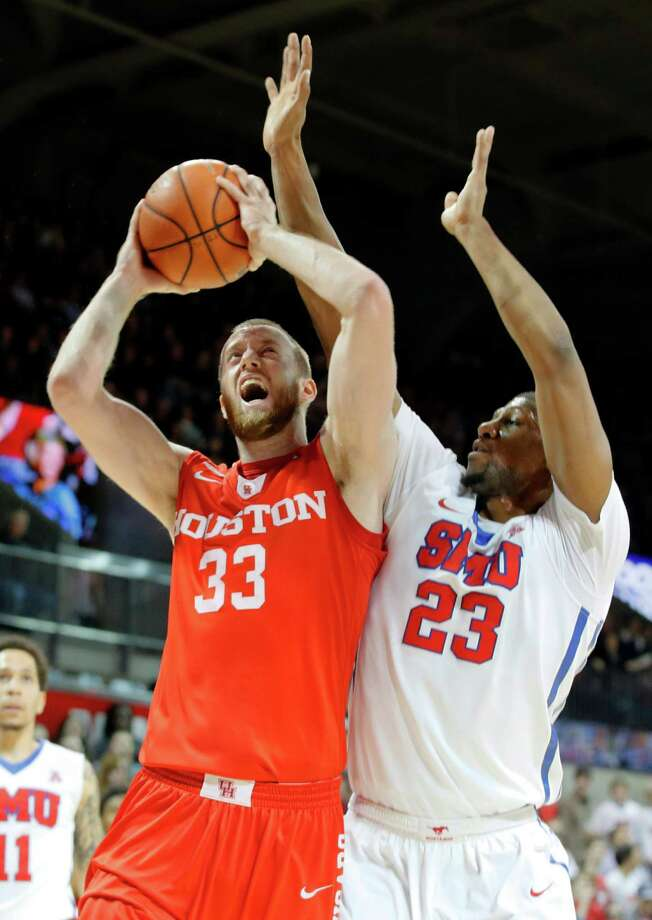 UH center Kyle Meyer (33) goes up for a shot against SMU forward Jordan Tolbert during the first half Tuesday night. Photo: Tony Gutierrez, STF / AP