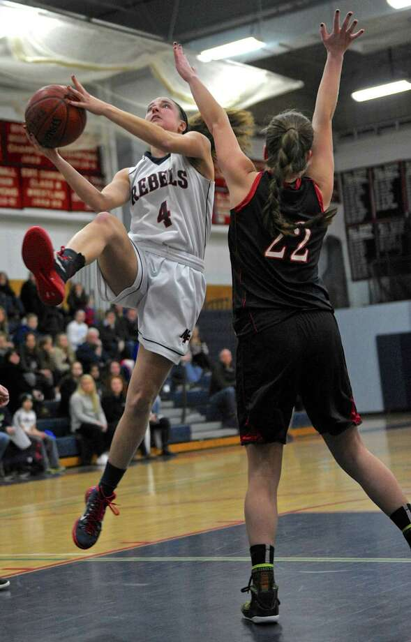 New Fairfield's Bridget Zima (4) drives to the basket past Pomperaug's Rachel Bonnanzio (22) in the girls basketball game between Pomperaug and New Fairfield high schools, on Tuesday night, January 19, 2016, at New Fairfield High School, in New Fairfield, Conn. Photo: H John Voorhees III / Hearst Connecticut Media / The News-Times
