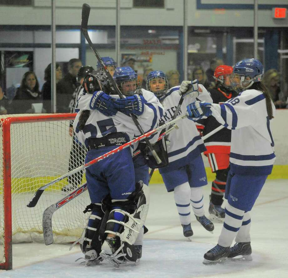 Darien goalie Emily Gianunzio celebrates the Blue Wave's 3-2 win over New Canaan in a girls varsity ice hockey game at the Darien Ice Rink in Darien, Conn. on Saturday. Photo: Matthew Brown / Hearst Connecticut Media / Stamford Advocate