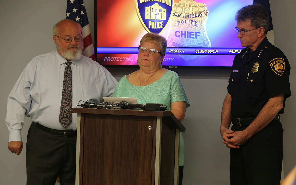 Charlotte Mott, center, speaks to the media Oct. 16 at Public Safety Headquarters about her daughter's missing body. The body of Julie Mott went missing in August from Mission Park Funeral Chapel North. The Mott family is pleading with the public to come forward if they know anything about the whereabouts of Julie Mott's body. Anyone having knowledge about this is asked to call (210) 225-TIPS. On the left is Julie's father Tim, and on the right is Police Chief William McManus.