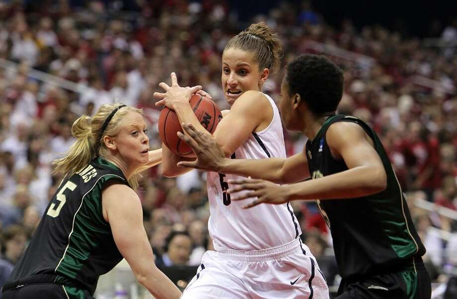 SAN ANTONIO - APRIL 04:  Guard Caroline Doty #5 of the Connecticut Huskies is pressured by Melissa Jones #5 and Shanay Washington #15 of the Baylor Bears during the Women's Final Four Semifinals at the Alamodome on April 4, 2010 in San Antonio, Texas.  (Photo by Ronald Martinez/Getty Images) *** Local Caption *** Caroline Doty;Shanay Washington;Melissa Jones Photo: Ronald Martinez, Getty Images / 2010 Getty Images