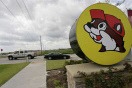 Cars are seen entering and leaving the Buc-ee's convenience store/gas station on Sunday, Oct. 5, 2008, in Pearland. ( Julio Cortez / Chronicle )