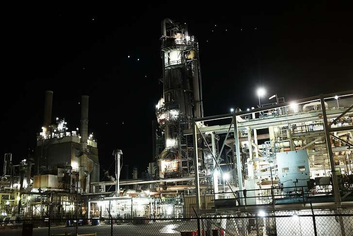 BIG SPRING, TX - JANUARY 19: An oil refinery is lit up in the night on January 19, 2016 in Big Spring, Texas. Global oil prices continue their downward fall with U.S. oil dropping towards $27 a barrel, its lowest since 2003, on worries about global oversupply. Following a diplomatic agreement on nuclear fuel with America, Iran has forecast it will add 500,000 barrels per day to global production, following the lifting of sanctions. (Photo by Spencer Platt/Getty Images)