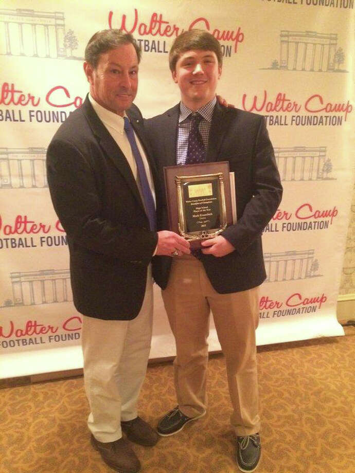Darien coach Rob Trifone (left) and Mark Evanchick pose at the Walter Camp Foundation banquet. Trifone and Evanchick won the Coach of the Year and Player of the Year, respectively. Photo: Contributed / Darien News